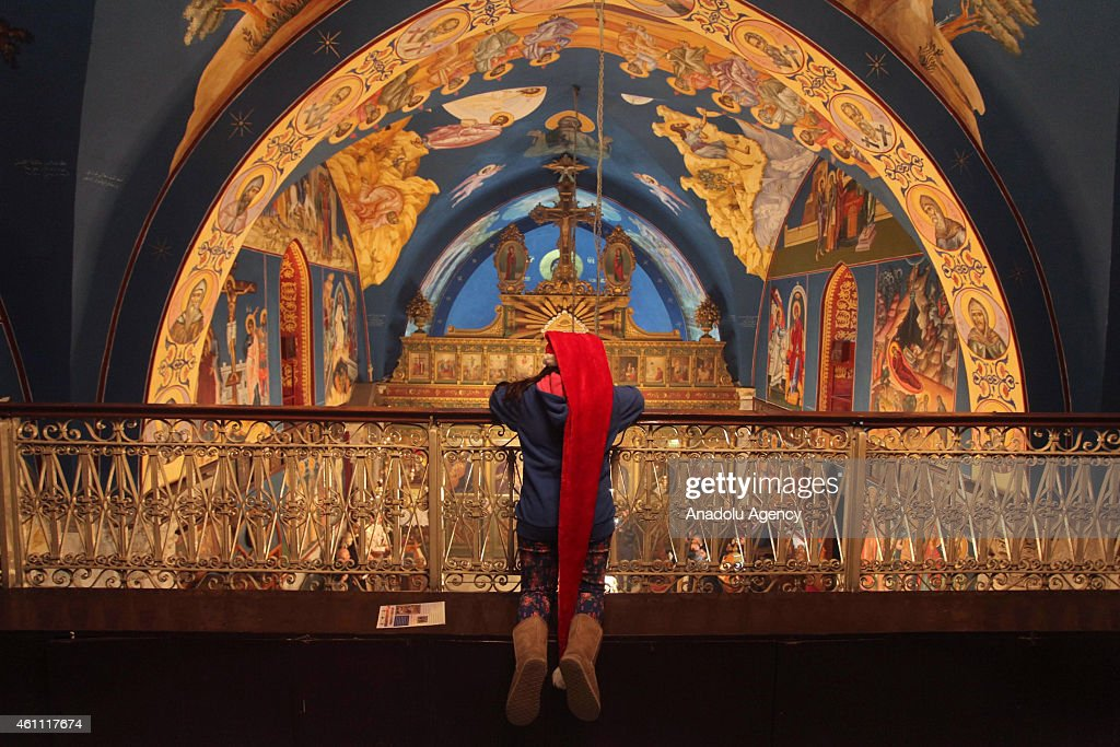 Orthodox Christians attend Christmas mass at Greek Orthodox Church in Gaza City Gaza on January 07 2015 Orthodox Christians celebrate Christmas on...