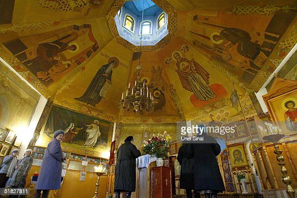Orthodox Christians attend church December 5 2004 in Donetsk Ukraine The city with a population of over 1 million is situated in the southeast of the...