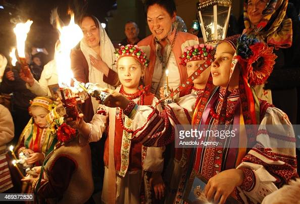 Orthodox Christians attend 'Holy Fire' mass on Holy Saturday ahead of the Easter at Vladimir Cathedral Church in Kiev on April 11 2015 Holy Fire is...