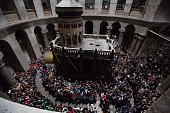 Orthodox Christians attend the 'Holy Fire' mass on Holy Saturday ahead the Easter at Church of the Holy Sepulchre in Jerusalem April 11 2015 Holy...