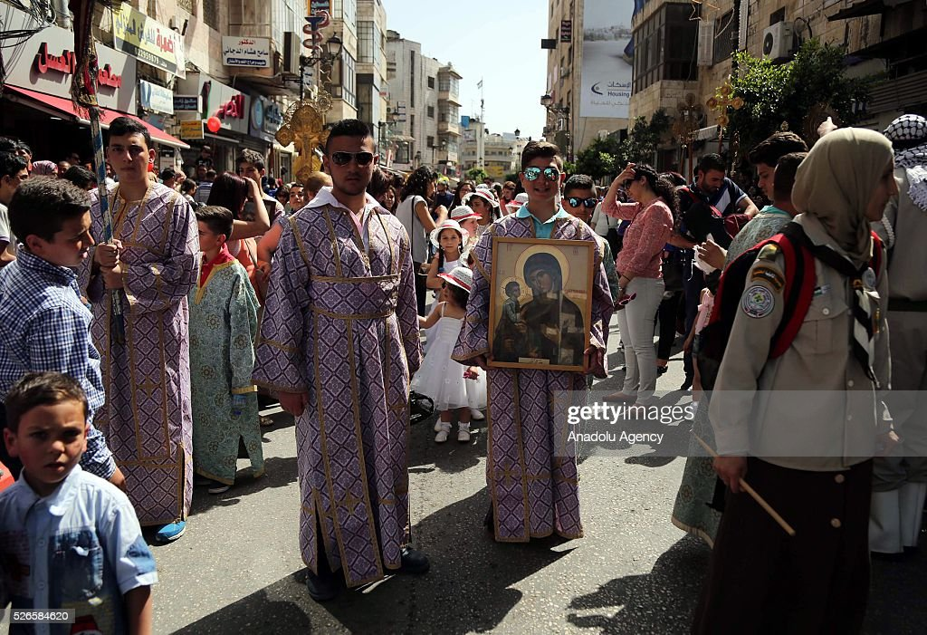 Orthodox Christians attend the 'Holy Fire' parade on Holy Saturday ahead the Easter at the streets of Ramallah in West Bank on April 30, 2016. Holy Fire is described by Orthodox Christians as a miracle that occurs every year at the Church of the Holy Sepulchre in Jerusalem on Holy Saturday.