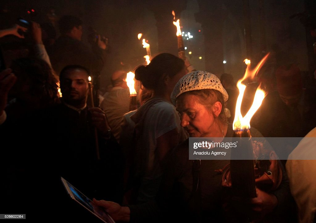 Orthodox Christians attend the 'Holy Fire' parade on Holy Saturday ahead the Easter at the Church of the Holy Sepulchre in West Bank on April 30, 2016. Holy Fire is described by Orthodox Christians as a miracle that occurs every year at the Church of the Holy Sepulchre in Jerusalem on Holy Saturday.