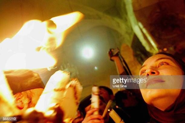 Orthodox Christians light their candles in the Holy Fire ceremony at what is traditionally believed to be the tomb of Jesus Christ in the Church of...