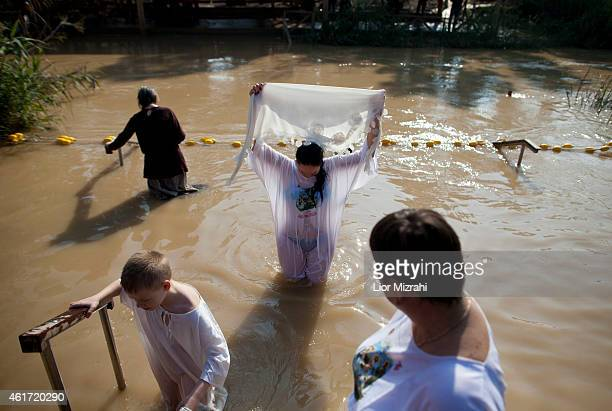 Orthodox Christians pilgrims are baptized during an Epiphany celebrations in the Jordan River at the Qasir alYahud baptismal on January 18 2015 near...