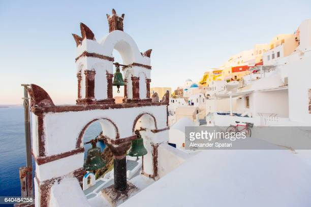 Orthodox church and its bell tower in Oia village, Santorini, Cyclades, Greece