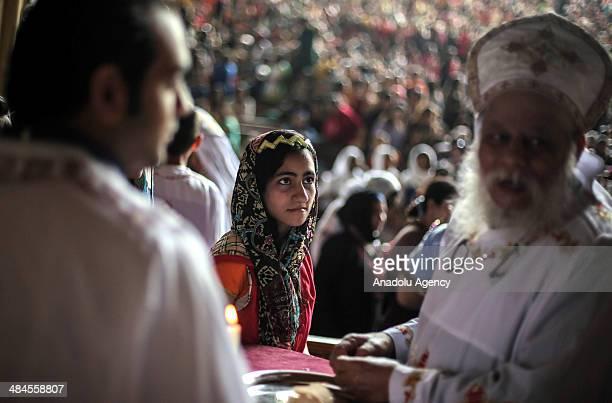 Orthodox Coptic Christians live in Egypt celebrate 'Palm Sunday' in Simon Kheras Church in Cairo Egypt on April 13 2014 Palm Sunday is celebrated on...