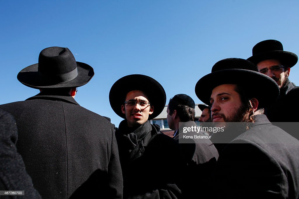 Orthodox Jewish men attend the funeral for seven children that died in a house fire on March 22 2015 in the Brooklyn borough of New York City...