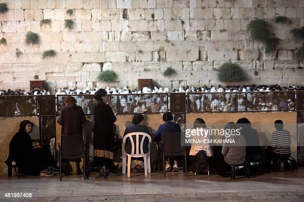 Orthodox Jewish women and men pray during the annual Tisha B'Av fasting and a memorial day commemorating the destruction of ancient Jerusalem temples...