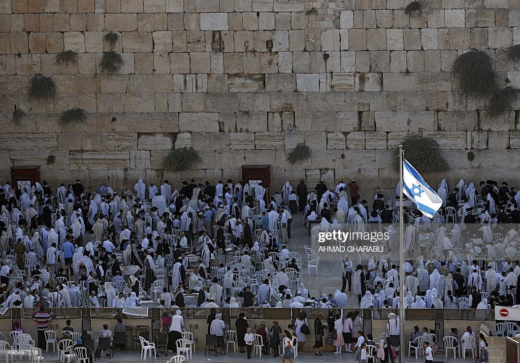 Orthodox Jewish worshippers perform prayers during the Sukkot or the feast of the Tabernacles holiday at the Western Wall in the Old City of...
