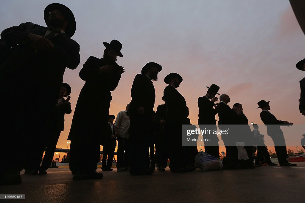 Orthodox Jews gather to celebrate the completion of study of the entire Talmud religious text outside MetLife Stadium on August 1 2012 in East...