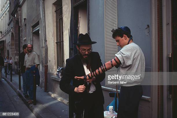 Orthodox Jews wrapping tefillin in Le Marais Paris October 1990