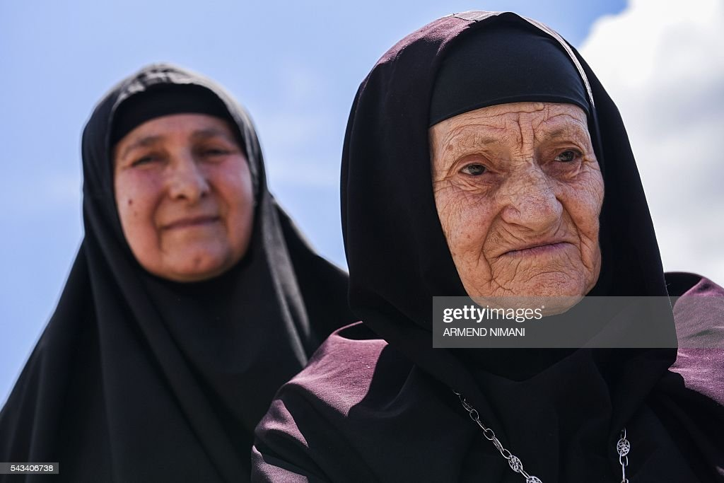 Orthodox nuns congregate at the Gazimestan memorial, near the village of Mazgit, Kosovo, as people take part in a ceremony marking the historic 'Battle of Kosovo' on June 28, 2016. The ceremony marks the Battle of Kosovo in 1389 when the Serbian army was defeated by the Ottoman Empire. / AFP / ARMEND