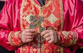 Orthodox priest holding ritual crest.