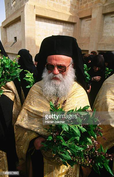 Orthodox Priest with basil leaves, Blessing of the Holy Water ceremony, Qasr al Yahud near Jericho.