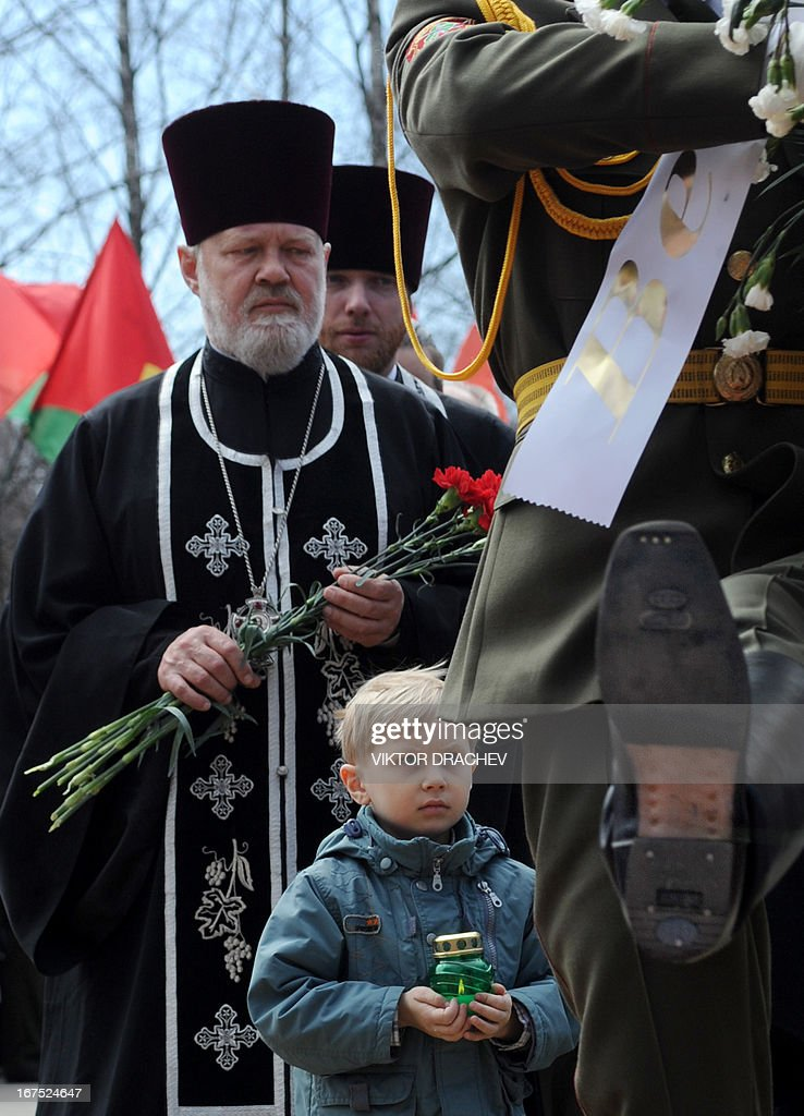 Orthodox priests attend a commemorative ceremony at the Chernobyl victims' memorial in the Belarus capital Minsk on April 26, 2013. The world marked today the 27th anniversary of the world's worst nuclear disaster at Chernobyl nuclear pant in Ukraine.
