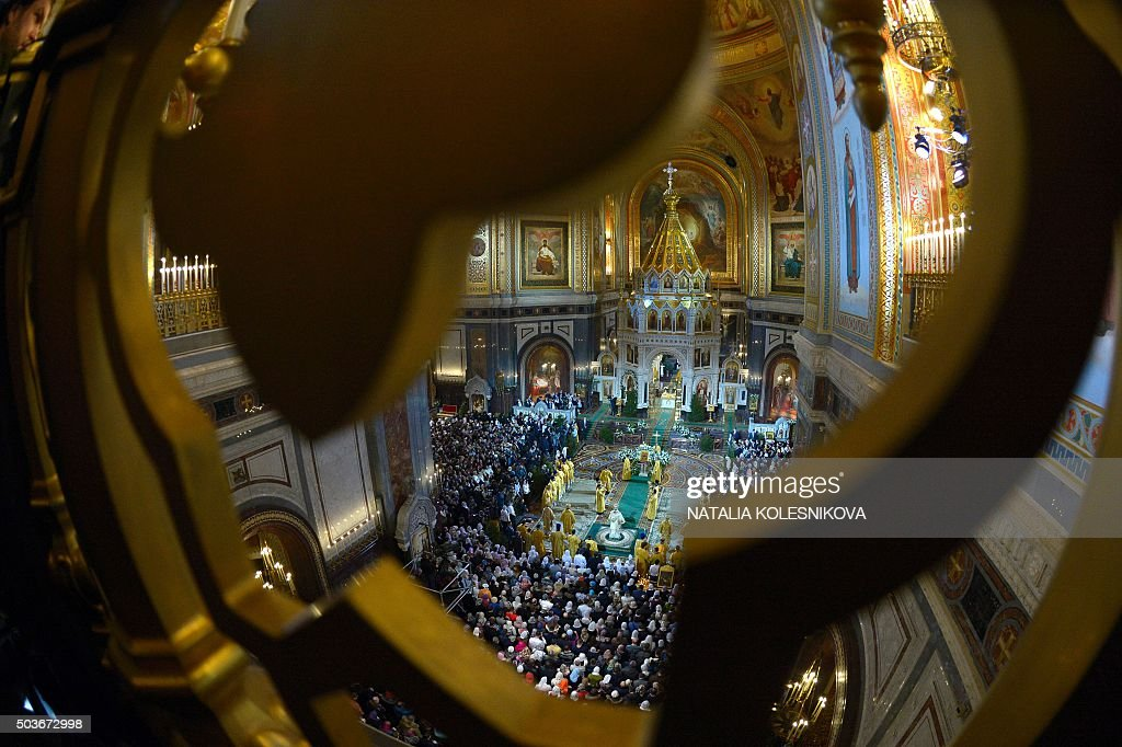 Orthodox priests attend the Christmas service in Christ the Savior cathedral in Moscow early on January 7 2016 Orthodox Christians celebrate...