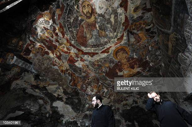 Orthodox priests get ready for the Virgin Mary service at the ancient Sumela Monastery in the Black Sea coastal province of Trabzon northeastern...