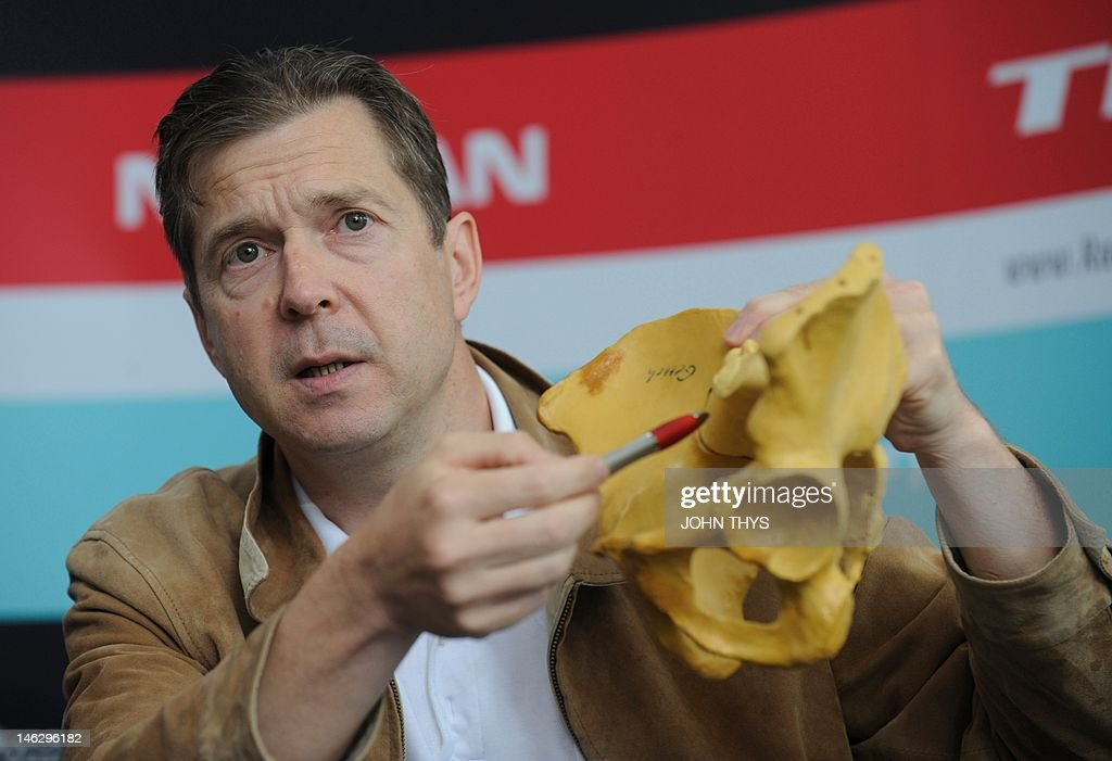 Orthopedic surgeon Doctor Torsten Gerich, who performed the MRI scan which revealed the sacral fracture of Cyclist Andy Schleck displays a model showing the point of the fracture during a press conference in Strassen on June 13, 2012. The Yellow jersey contender Andy Schleck has pulled out of this year's Tour de France due to injuries suffered in last week's Criterium du Dauphine race.