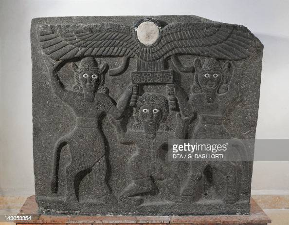 Orthostates depicting Gilgamesh between two minotaur demigods holding up the sun disc artefacts from Tell Halaf Syria Assyrian civilisation 9th...
