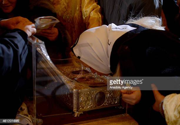 Ortodox Christians look at the Gifts of the Magi box as they celebrate the Orthodox Christmas at the Christ the Savior Cathedral in Moscow Russia...