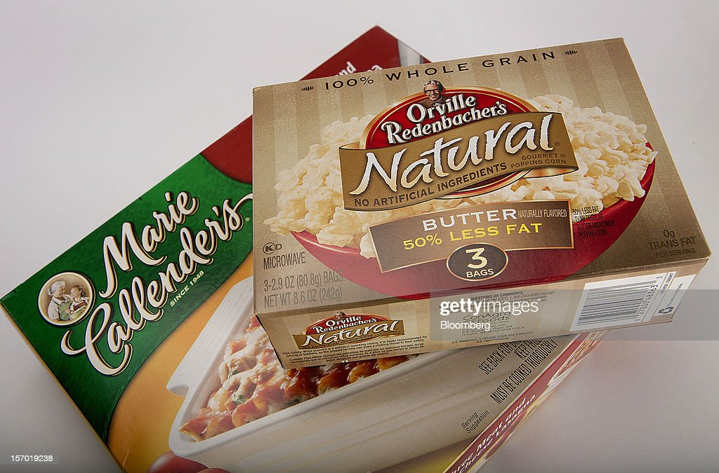 Orville Redenbacher's popcorn and a Marie Callender's frozen dinner, food products made by ConAgra Foods Inc., are arranged for a photograph in New York, U.S., on Tuesday, Nov. 27, 2012. ConAgra Foods Inc. agreed to acquire Ralcorp Holdings Inc. for about $5 billion, creating one of the largest packaged food companies in North America and concluding a pursuit that included three rejections since March last year. Photographer: Scott Eells/Bloomberg via Getty Images