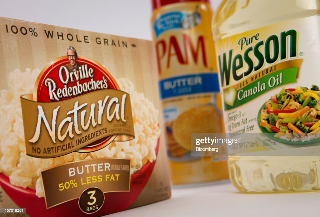 Orville Redenbacher's popcorn, Wesson Canola oil and Pam non-stick spray, food products made by ConAgra Foods Inc., are arranged for a photograph in New York, U.S., on Tuesday, Nov. 27, 2012. ConAgra Foods Inc. agreed to acquire Ralcorp Holdings Inc. for about $5 billion, creating one of the largest packaged food companies in North America and concluding a pursuit that included three rejections since March last year. Photographer: Scott Eells/Bloomberg via Getty Images