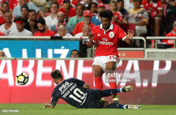 Os Belenenses forward Diogo Viana from Portugal tackles Benfica's defender Eliseu from Portugal during the match between SL Benfica and CF Belenenses...