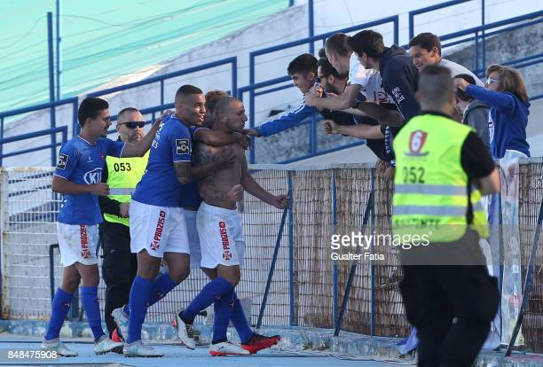 Os Belenenses midfielder Andre Sousa from Portugal celebrates with teammates after scoring a goal during the Primeira Liga match between CF Os...