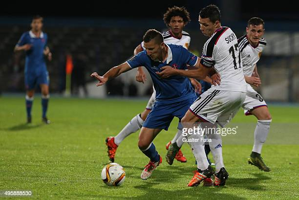 Os Belenenses' midfielder Andre Sousa with FC Basel 1893's defender Marek Suchy in action during the UEFA Europa League match between Os Belenenses...