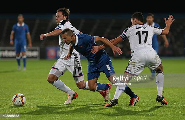 Os Belenenses' midfielder Andre Sousa with FC Basel 1893's defender Marek Suchy and FC Basel 1893's midfielder Luca Zuffi in action during the UEFA...