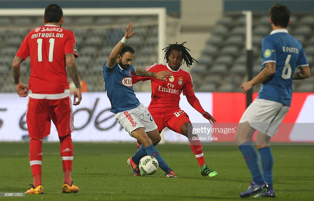 Os Belenenses' midfielder <a gi-track='captionPersonalityLinkClicked' href=/galleries/search?phrase=Carlos+Martins&family=editorial&specificpeople=685923 ng-click='$event.stopPropagation()'>Carlos Martins</a> with SL Benfica's midfielder Renato Sanches in action during the Primeira Liga match between Os Belenenses and SL Benfica at Estadio do Restelo on February 5, 2016 in Lisbon, Portugal.
