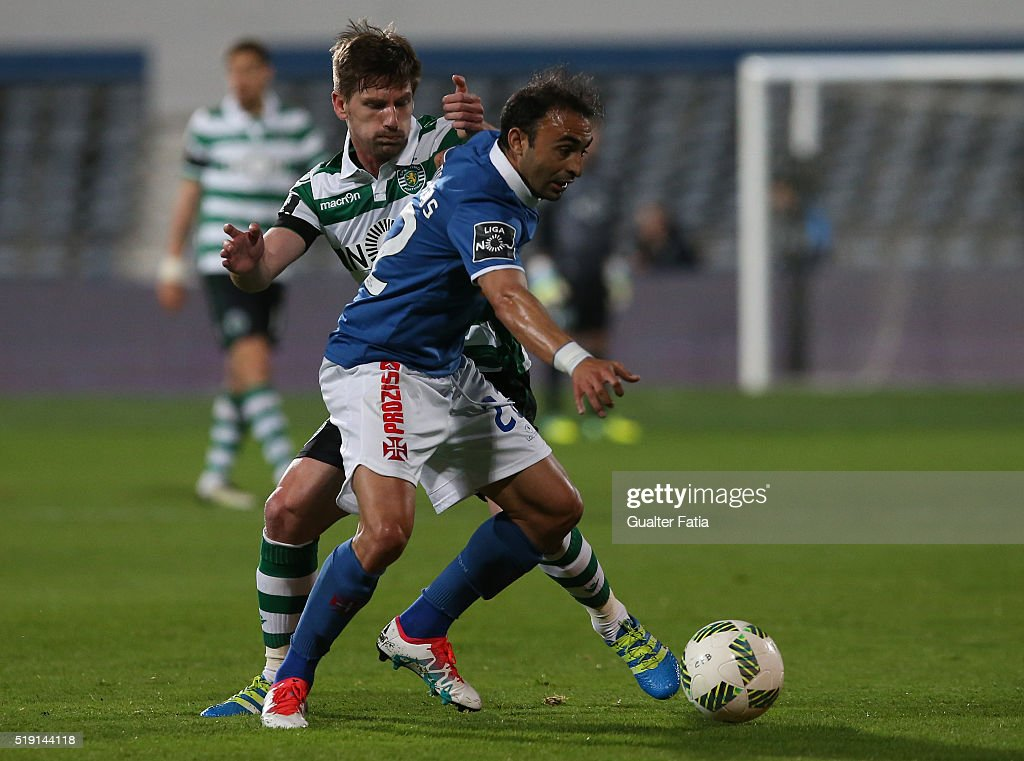 Os BelenensesÕ midfielder <a gi-track='captionPersonalityLinkClicked' href=/galleries/search?phrase=Carlos+Martins&family=editorial&specificpeople=685923 ng-click='$event.stopPropagation()'>Carlos Martins</a> with Sporting CP's midfielder <a gi-track='captionPersonalityLinkClicked' href=/galleries/search?phrase=Adrien+Silva&family=editorial&specificpeople=2202656 ng-click='$event.stopPropagation()'>Adrien Silva</a> in action during the Primeira Liga match between Os Belenenses and Sporting CP at Estadio do Restelo on April 4, 2016 in Lisbon, Portugal.