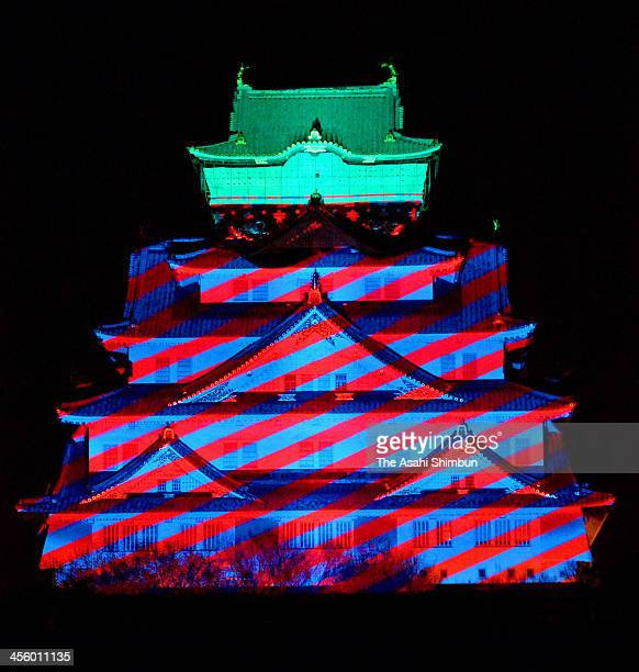 Osaka Castle main building is illuminated during the preview of the Osaka Castle 3D Mapping Super Illumination show on December 12 2013 in Osaka...