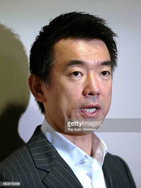 Osaka City mayor and the Japan Innovation Party co leader Toru Hashimoto speaks to media reporters at Osaka City Hall on December 24 2014 in Osaka...