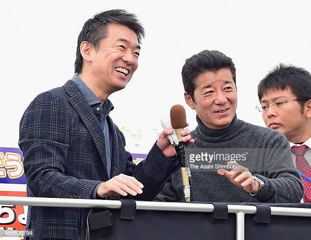 Osaka City Mayor Toru Hashimoto and Osaka Prefecture Governor Ichiro Matsui of the local party Osaka Ishinnokai call for support during their street...