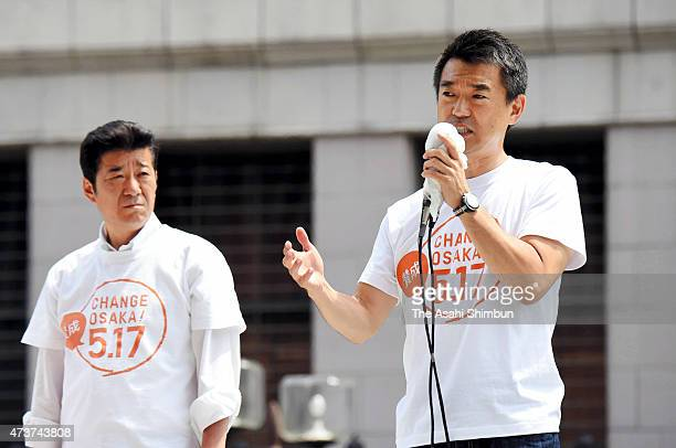 Osaka City Mayor Toru Hashimoto makes a street speech while Osaka Prefecture Governor Ichiro Matsui listens on the voting day of the referendum on...
