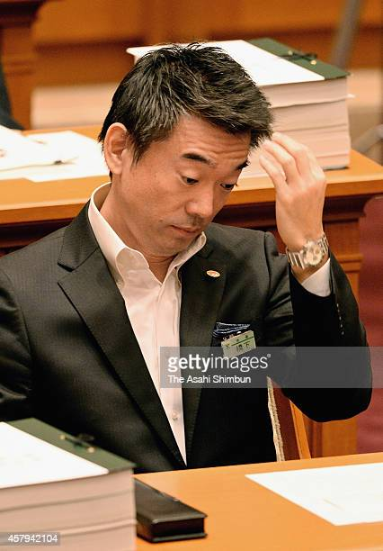 Osaka City Mayor Toru Hashimoto reacts after the greater Osaka Metropolitan government bill was rejected at Osaka City Assembly on October 27 2014 in...