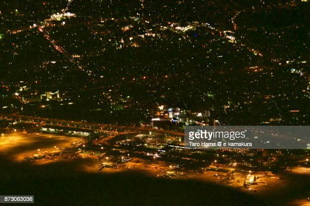 Osaka International Airport (Itami Airport) in Hyogo prefecture in Japan night time aerial view from airplane