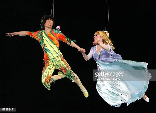Actors playing Peter Pan and Jane Wendy's daughter perform during the press preview of Peter Pan's Neverland the new attraction to commemorate the...