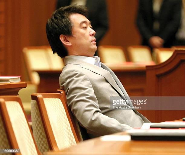 Osaka mayor Toru Hashimoto leans back on a chair before Osaka city assembly rejected the censure motion against Hashimoto at Osaka City Hall on May...