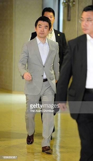 Osaka mayor Toru Hashimoto walks a corridor before Osaka city assembly rejected the censure motion against Hashimoto at Osaka City Hall on May 30...