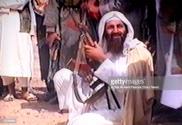 Osama bin Laden holds an automatic weapon in this undated still frame from a recruitment video for his extremist AlQaida network