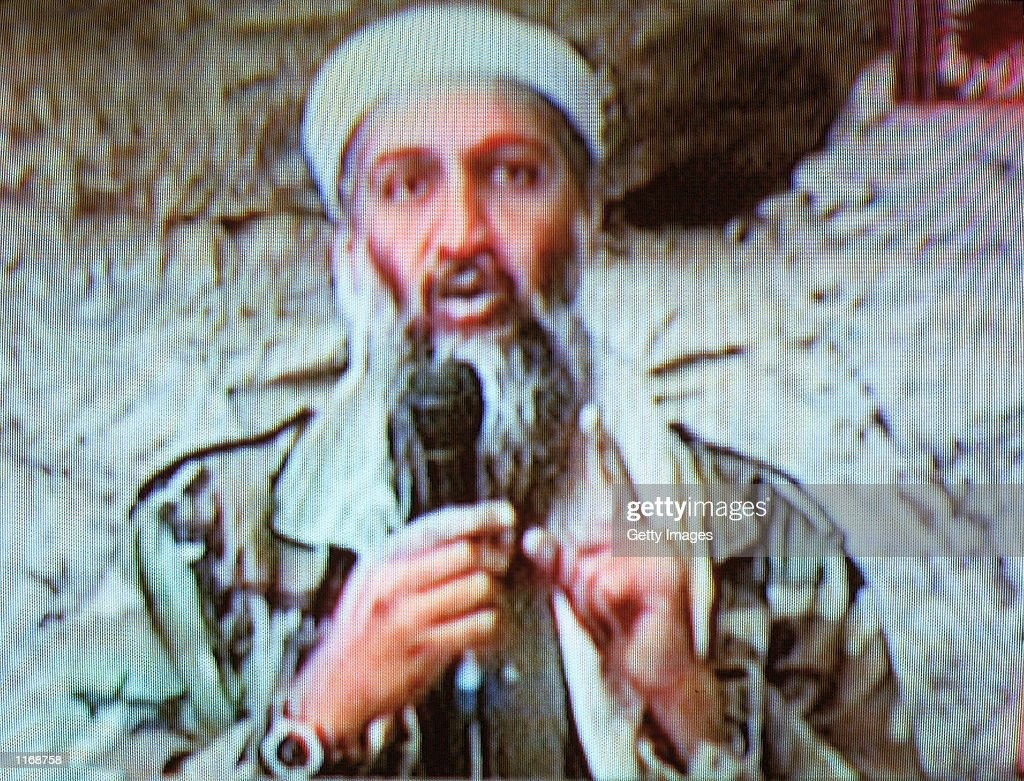 Osama bin Laden is seen at an undisclosed location in this television image broadcast October 7 2001 from Al Jazeera Television in Qatar Bin Laden...