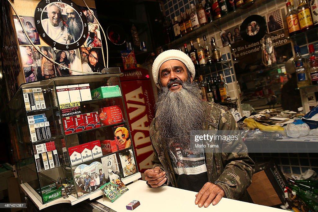 Osama bin Laden lookalike Ceara Francisco Helder Braga Fernandes poses in his 'Bar do Bin Laden' on April 29 2014 in Sao Paulo Brazil Braga says he...