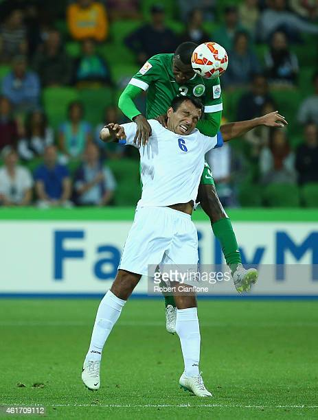 Osama Hawsawi of Saudi Arabia heads the ball over Bakhodir Nasimov of Uzbekistan during the 2015 Asian Cup match between Uzbekistan and Saudi Arabia...