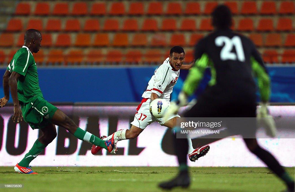 Osama Hawsawi (L) of Saudi Arabia tries to block a shot by Yaghoub Karimi (C) of Iran during their 7th West Asia Football Federation (WAFF) championship football match in Kuwait City on December 9, 2012.