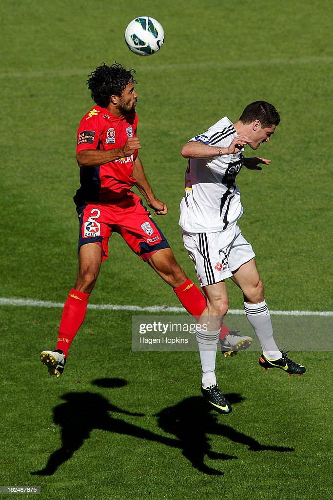 Osama Malik of Adelaide and Corey Gameiro of the Phoenix compete for a header during the round 22 A-League match between the Wellington Phoenix and Adelaide United at Westpac Stadium on February 24, 2013 in Wellington, New Zealand.