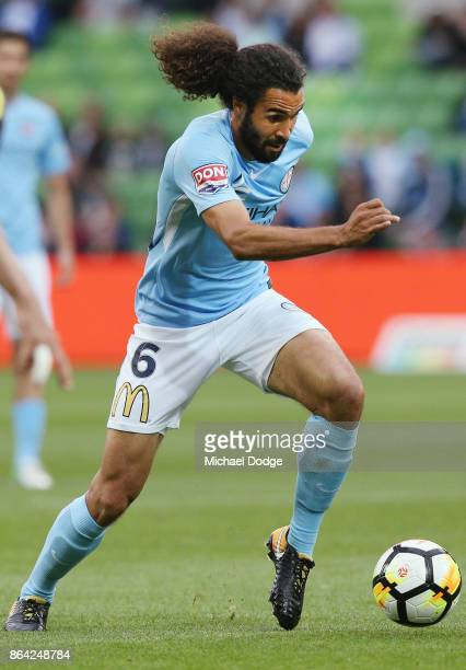 Osama Malik of the City runs with the ball during the round three ALeague match between Melbourne City and the Wellington Phoenix at AAMI Park on...