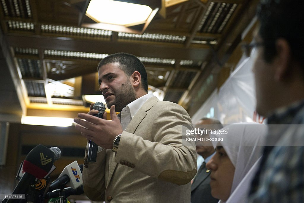 Osama Mohamed Morsi son of Egypt's ousted president Mohamed Morsi speaks during a press conference in Cairo on July 22, 2013. The family of Morsi is to take legal action against Egypt's army chief, General Abdel Fattah al-Sisi, for 'kidnapping' the Islamist president, his daughter Shaimaa Mohamed said. AFP PHOTO / KHALED DESOUKI