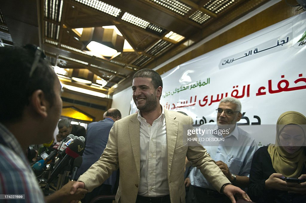 Osama Mohamed Morsi, the son of Egypt's ousted president Mohamed Morsi, leave after a press conference in Cairo, on July 22, 2013. The family of Morsi is to take legal action against Egypt's army chief, General Abdel Fattah al-Sisi, for 'kidnapping' the Islamist president, Shaimaa said.